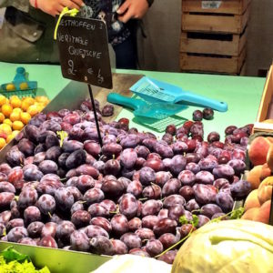 Quetsche and mirabelles for sale at the Strasbourg market.